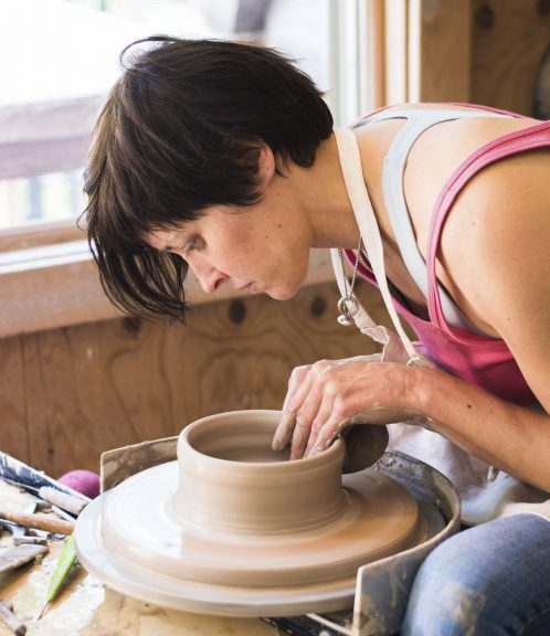 Sarah Lindley at the pottery wheel